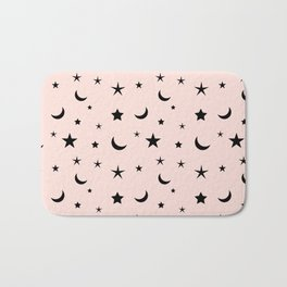 Black moon and star pattern on pink background Bath Mat
