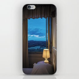 Panoramic view of the rolling hills of Chianti through a window at sunset iPhone Skin