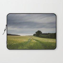 Evening clouds sweep over a wind blown barley field. East Lexham, Norfolk, UK. Laptop Sleeve