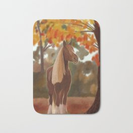 Blond and brown horse in fall Bath Mat