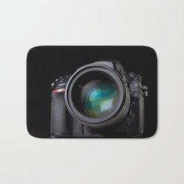 DSLR camera on black Bath Mat