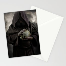 Holding a male skull Stationery Cards