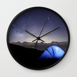 Illuminated tent in mountains at night Wall Clock