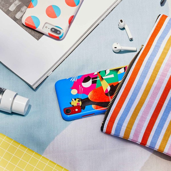 brightly colored phone cases on picnic blanket