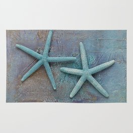 Turquoise Starfish on textured Background Rug