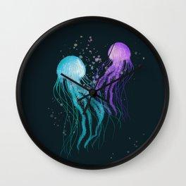Couple Jellyfish dancing in the dark sea Wall Clock
