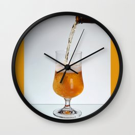 Fresh beer filling glass on stem Wall Clock