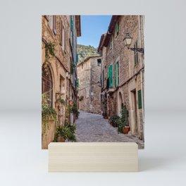Narrow street in Valldemossa village - Mallorca, Spain Mini Art Print