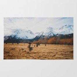 Peaceful New Zealand mountain landscape Rug