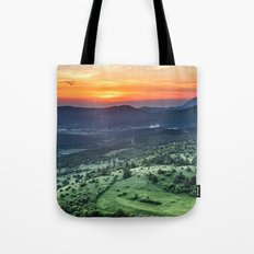 Beautiful sunset behind green fields Tote Bag
