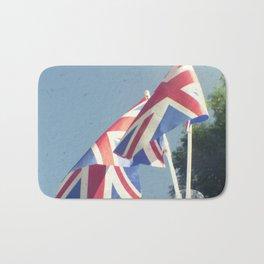 Flags - Union Jacks against a blue sky Bath Mat