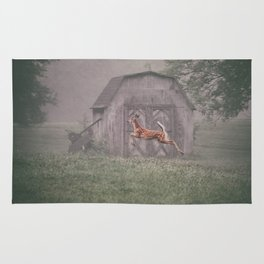 Leaping deer in front of barn with foggy background Rug
