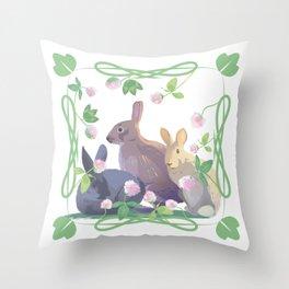 Bunnies and clover Throw Pillow