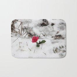Rose in the snow Bath Mat