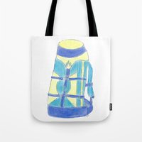 backpack Tote Bags featuring A backpack yellow by Atelier Pora