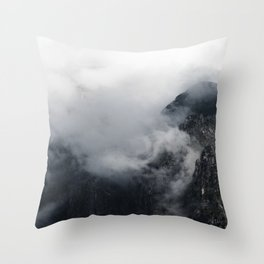 White clouds over the dark rocky mountains Throw Pillow