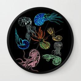 Ammonites at Night Wall Clock