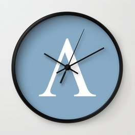 Greek letter lambda sign on placid blue background Wall Clock