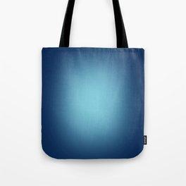 White spotlight on blue Tote Bag
