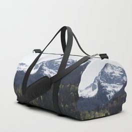 Winter and Spring - green trees and snowy mountains Duffle Bag