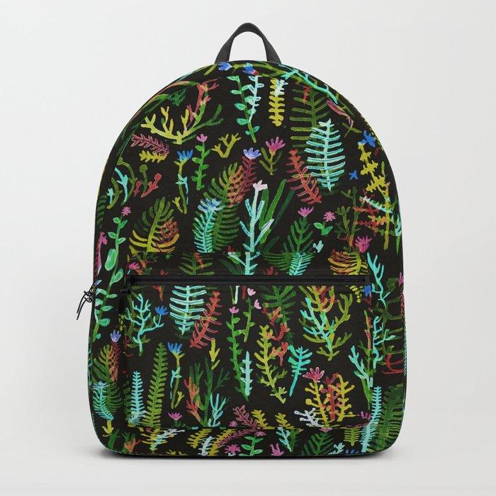 dark gaden with color flowers Backpack