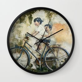 Oriental brother and sister riding a bicycle painted on a rusty wall somewhere in Asia. Wall Clock