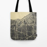 cleveland Tote Bags featuring Cleveland map by Map Map Maps