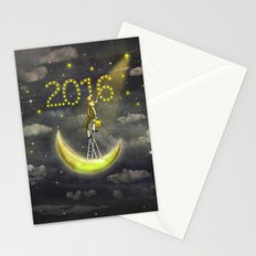 Old man draws  stars  at top of tall ladder in dark sky  Stationery Cards