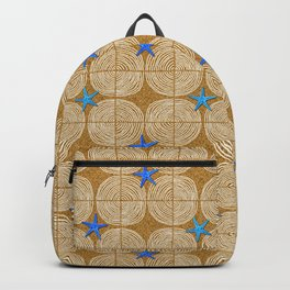 Blue starfish on a sandy beach Backpack