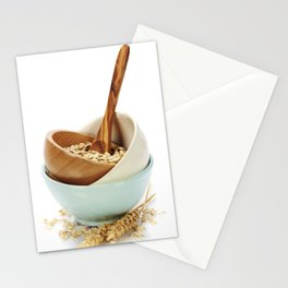 bowl of oat flakes on white background Stationery Cards