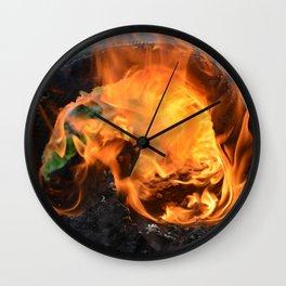 fire in a hollow log Wall Clock