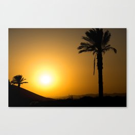 Golden Andalusian sunset with silhouette palm trees and mountain Canvas Print