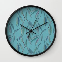 Eucalyptus leaves on sky blue Wall Clock