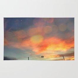Love birds in the sunset Rug
