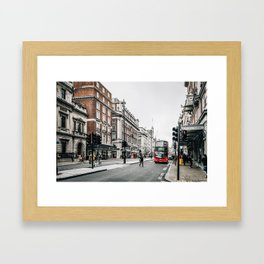 Red bus in Piccadilly street in London Framed Art Print