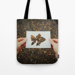 holding golden fish Tote Bag