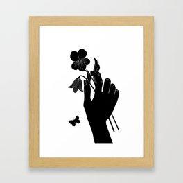Black Hand Holding Flowers Framed Art Print