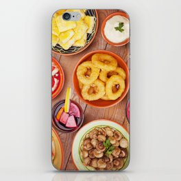 I - Assortment of Spanish tapas and sangria on a rustic table iPhone Skin
