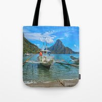 philippines Tote Bags featuring Palawan Beach Philippines by Clive Eariss