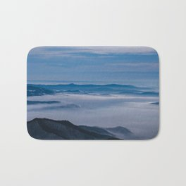 Misty winter Christmas morning over the mountain top Bath Mat