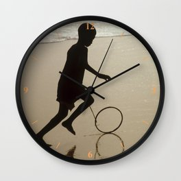 Silhouette on an African Beach. Wall Clock