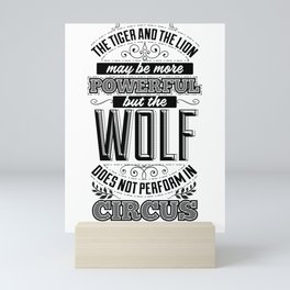 The tiger and the lion may be more powerful, but the wolf does not perform in circus. Mini Art Print