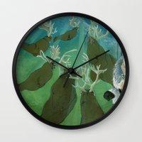 mythology Wall Clocks featuring Inuit Mythology: Chapter 1, part 7 by Estúdio Marte