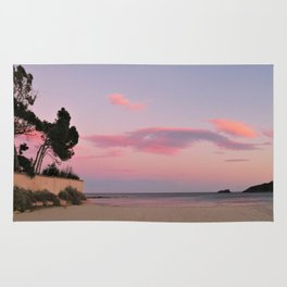 sunset at the beach Rug