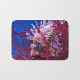 Lionfish (Dendrochirus brachypterus) in a red seaweed, blue background Bath Mat