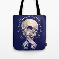 Tote Bags featuring Triple eyed skull by pakowacz