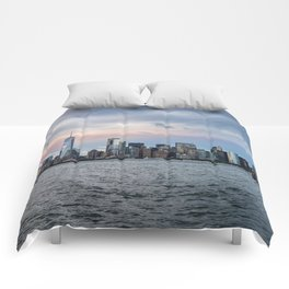 Skyline  of New York City at sunset Comforters