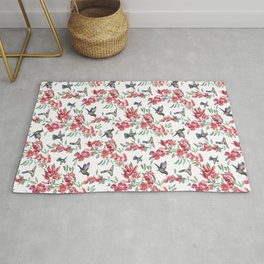 hummingbird with ceibo tree flowers Rug
