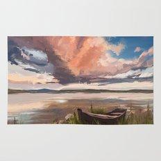 Sunrise over the lake Rug