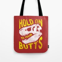 trex Tote Bags featuring Hold on to your butts by Zeke Tucker